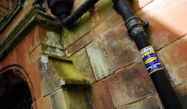 Church and drain pipe with Smartwater sticker